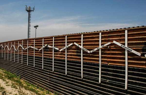 A section of existing wall along the U.S.-Mexico border. - WIKIMEDIA COMMONS