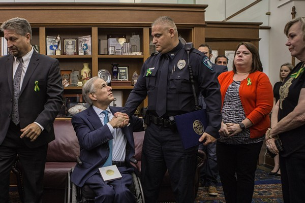Greg Abbott shakes the hand of a participant in his school safety roundtable. - VIA GOV. GREG ABBOTT'S FLICKR PAGE