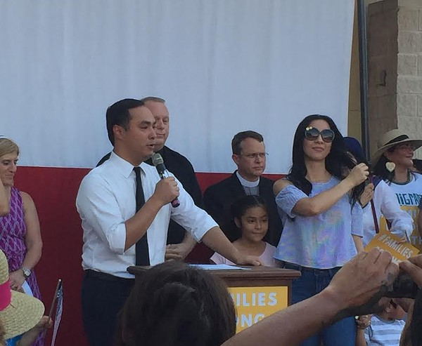 Joaquin Castro speaks at the West Side rally, surrounded by his family and local faith leaders. - SANFORD NOWLIN