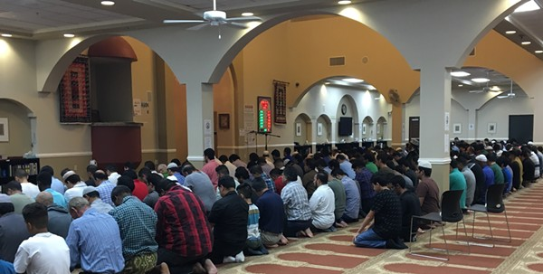 Muslims at the MCECC joined for prayer before and after they broke fast on Thursday, the last day of Ramadan. - MEGAN RODRIGUEZ