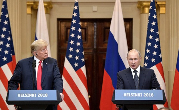 President Trump listens while Russian President Vladimir Putin speaks at the press conference following their Helsinki summit. - WIKIMEDIA COMMONS