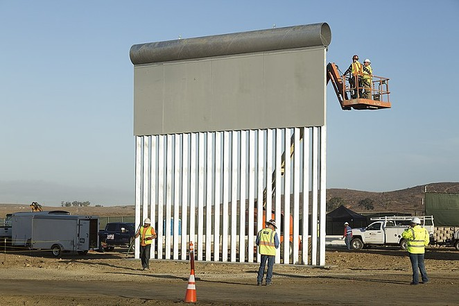 Workers construct a prototype of the proposed border wall near the Otay Mesa Port of Entry in San Diego. - MANI ALBRECHT (WIKIMEDIA COMMONS)