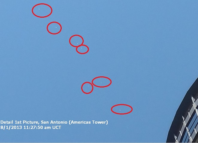This image purports to show several unexplained flying objects sighted above San Antonio's Tower of the Americas. - VIA URBAN 15