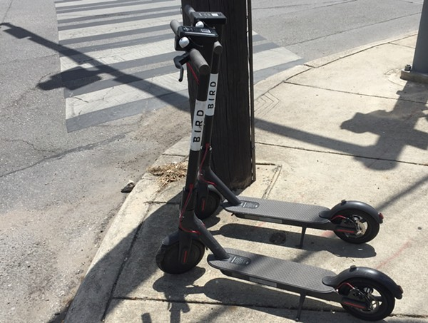 A pair of dockless scooters sit on a sidewalk along North St. Mary's Street. - SANFORD NOWLIN