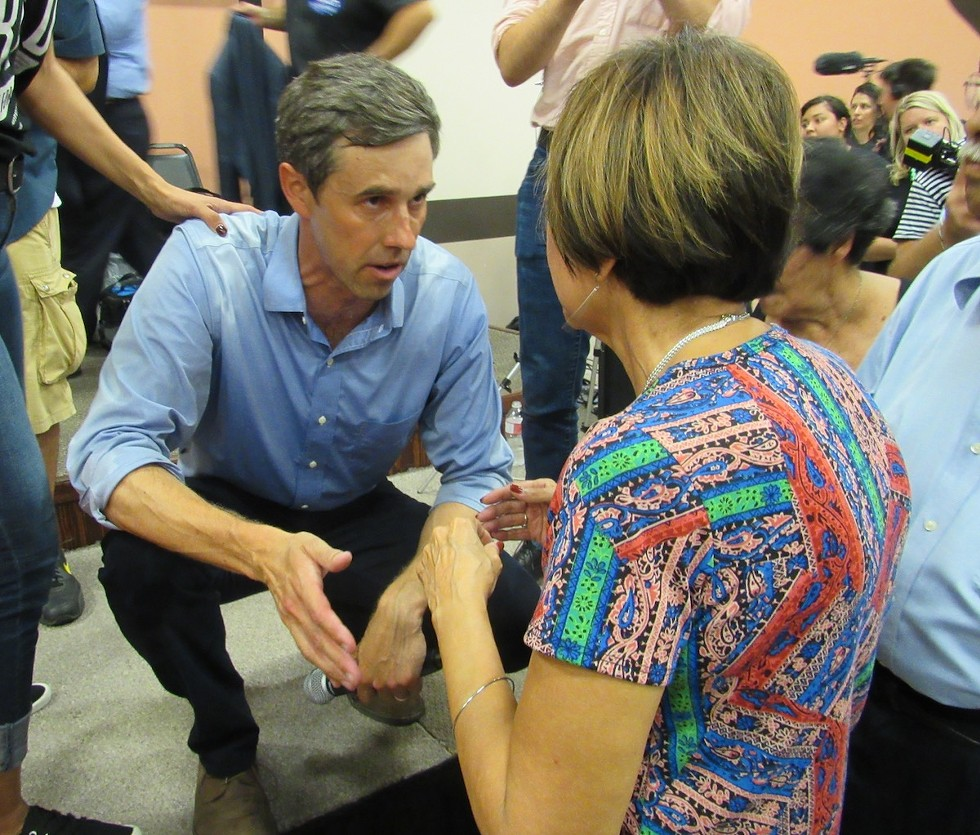 O'Rourke speaks to an audience member from the stage after the Corpus Christi town hall that drew more than 1,000 people. - SANFORD NOWLIN
