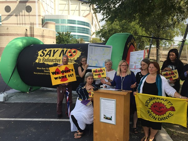 Environmental activists speak out against a plan to ship nuclear waste via Texas railways during a press conference in front of the Alamodome. - SANFORD NOWLIN