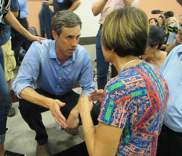 O'Rourke speaks to an audience member from the stage after a Corpus Christi town hall that drew more than 1,000 people. - SANFORD NOWLIN