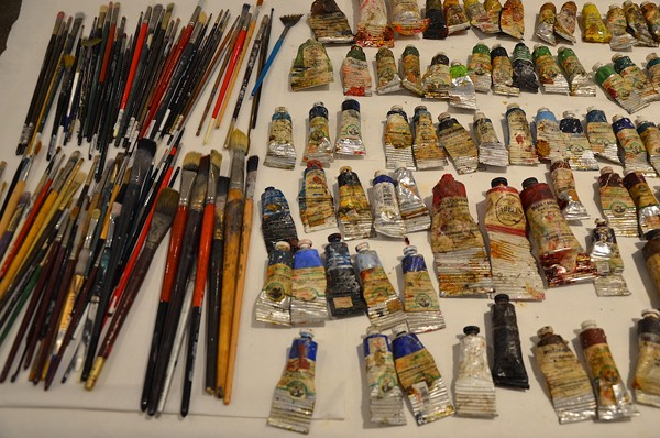 Paints and brushes in Ana Fernandez's workspace - PHOTO BY BRYAN RINDFUSS