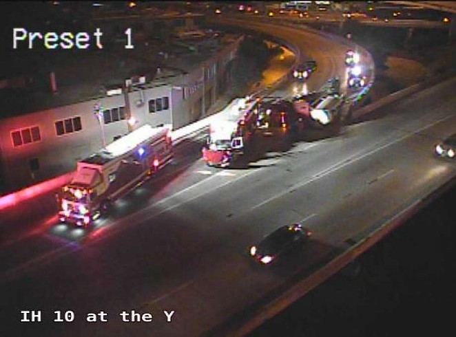 Emergency crews work to clear an overturned 18-wheeler at the Finesilver curve downtown. - TXDOT
