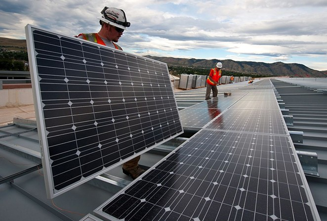 Workers conduct a solar panel installation project. - U.S. DEPARTMENT OF ENERGY