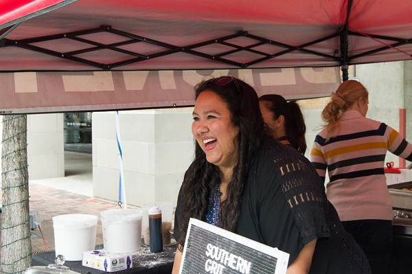 Elsa Treviño warmly greets and explains the Southern Grit menu to customers, and ensures that every order of beignets is delivered hot and fresh. - LEA THOMPSON