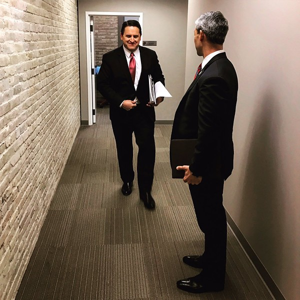 City manager candidate Erik Walsh (left) walks toward Mayor Ron Nirenberg, who voted today to approve Walsh to succeed Sheryl Sculley. - TWITTER / RON_NIRENBERG