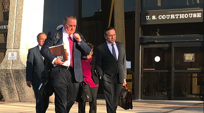 Uresti (right) leaves the federal courthouse with his legal team during his February 2018 trial. - ALEX ZIELINSKI
