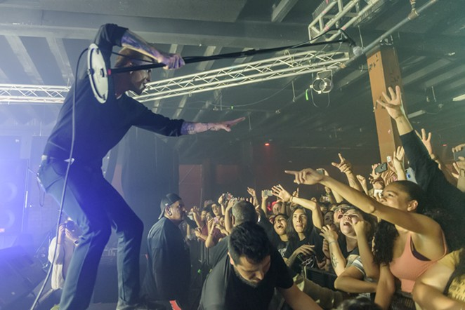 A member of Circa Survive and the crowd interact during a recent Alamo City Music Hall performance. - JAIME MONZON