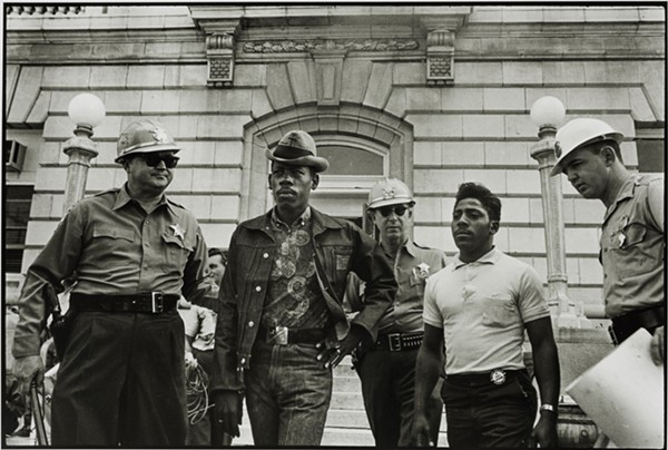 DANNY LYON, SHERIFF JIM CLARK ARRESTS TWO SNCC VOTER REGISTRATION WORKERS ON THE STEPS OF THE FEDERAL BUILDING, SELMA, ALABAMA, 1963