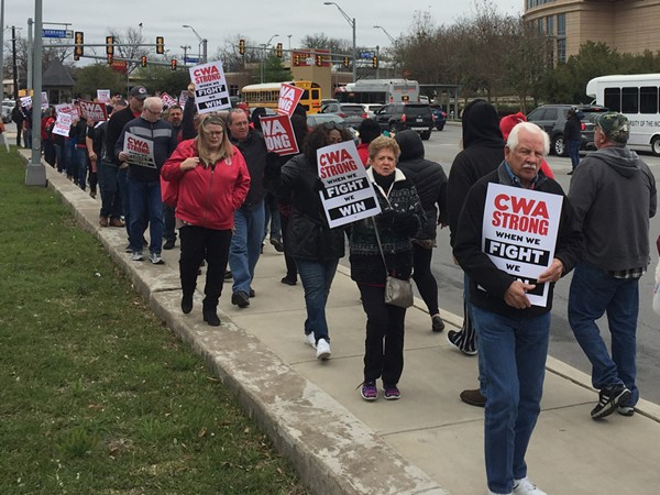 CWA union members march in front of the AT&T building on Broadway. - SANFORD NOWLIN