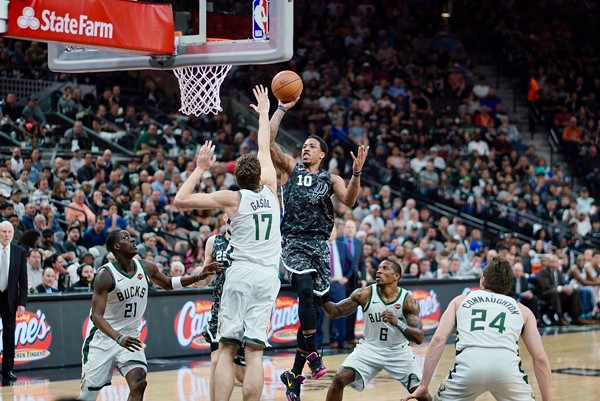 DeMar DeRozan drives to the basket against the Milwaukee Bucks. - TWITTER @SPURS
