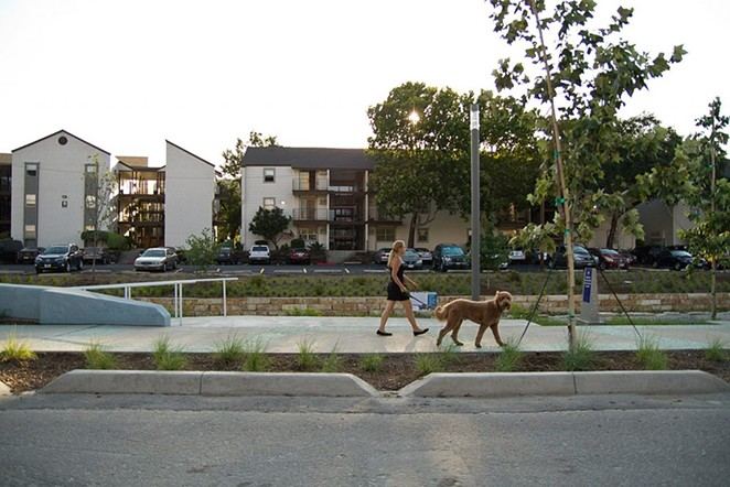 Some residents of the Soap Factory apartments, shown here with San Pedro Creek Culture Park in the foreground, have received relocation aid from the city. - HERON FILE PHOTO