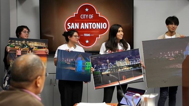 Briauna Barrera (from left), Natasha Hernandez, Yaneth Flores and Elionas Puente urge the City Council to act on a contentious piece of land north of the Hays Street Bridge. District 2 Councilman Art Hall (foreground), whose district encompasses the bridge, looks on. - BEN OLIVO / HERON