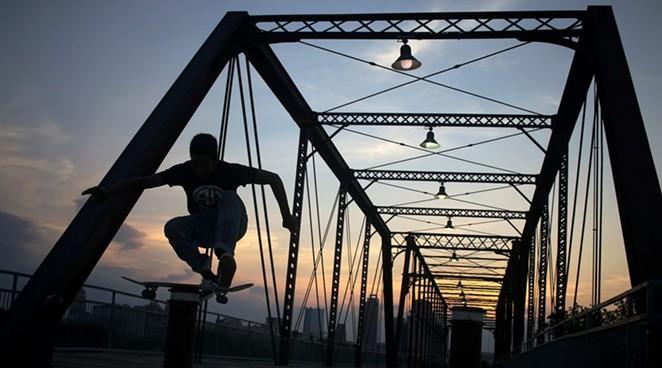 Jamal Nixon, 16, skates on the Hays Street Bridge recently. - NOAH ALCALA BACH | HERON CONTRIBUTOR