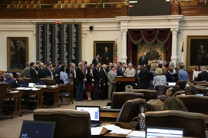 Texas lawmakers gather on the floor after passing an overhaul of the state's public chool finance system. - TWITTER / @REPDENNISBONNEN