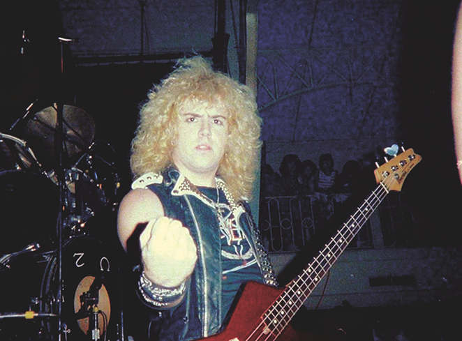 S.A. Slayer bassist and panelist Donnie Van Stavern pumps his fist in an early-'80s photo. - COURTESY