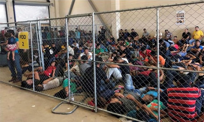 Families huddle together in an overcrowded cell at the Border Patrol's station in McAllen. - DEPARTMENT OF HOMELAND SECURITY OFFICE OF THE INSPECTOR GENERAL