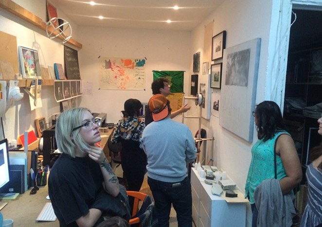 """Mexico City artist Miguel Ángel """"Wimpy"""" Salazar (in back) explains his work to a group of Texas State University students attending a study abroad program facilitated by AtrevesArte. - BRYAN RINDFUSS"""