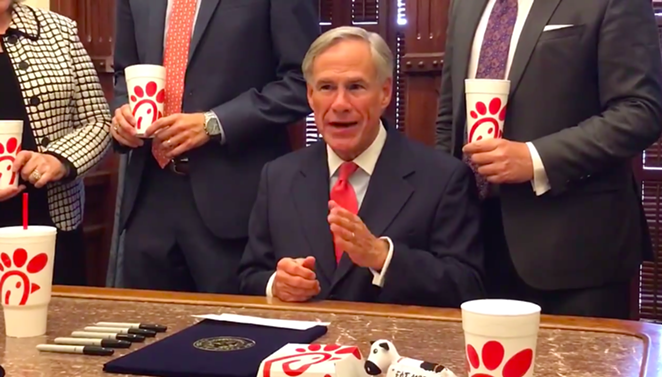 Gov. Greg Abbott makes a point about religious freedom with Chick-fil-A cups carefully arranged in the shot. - TWITTER / @GREGABBOTT_TX