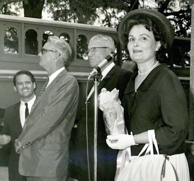 Mayor Lila Cockrell prepares to christen the San Antonio Museum of Art by breaking a bottle of beer against its façade. - TWITTER / @SAMAART
