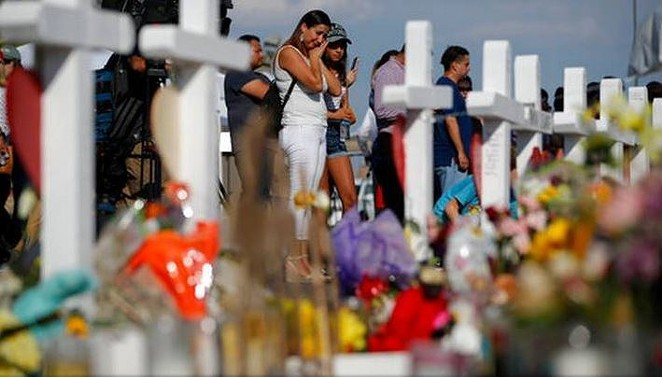 Mourners gather at a memorial for victims of the El Paso Walmart shooting. - WIKIMEDIA COMMONS / RUPERTO MILLER