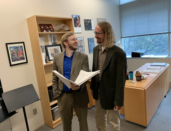 Joseph Kneer (left) and Brian Bondari share a laugh while reviewing the score of Symphony No. 2 - COURTESY OF TRINITY UNIVERSITY MUSIC DEPARTMENT