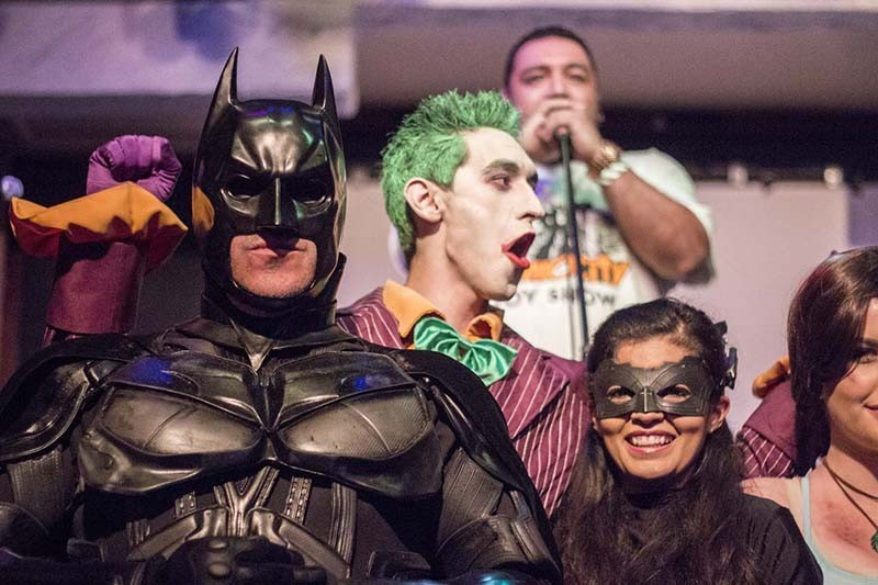 Apple De La Fuente (rear) emcees a costume event at the 2014 ACCC Thank You party. - RICK CANFIELD