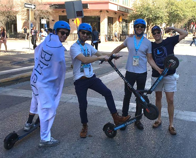 Attendees at a recent SXSW festival try out San Antonio company Blue Duck Scooters' rentable electric vehicles. - COURTESY OF BLUE DUCK SCOOTERS