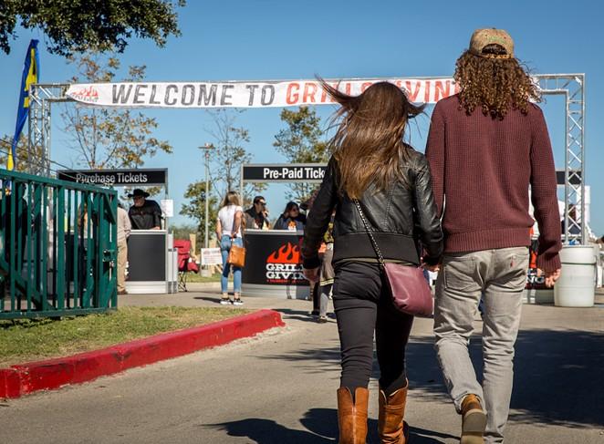 Guests enter GrillsGiving.