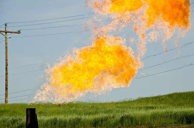 Natural gas burns from the flare-head of an oil well. - TIM EVANSON / WIKIMEDIA COMMONS