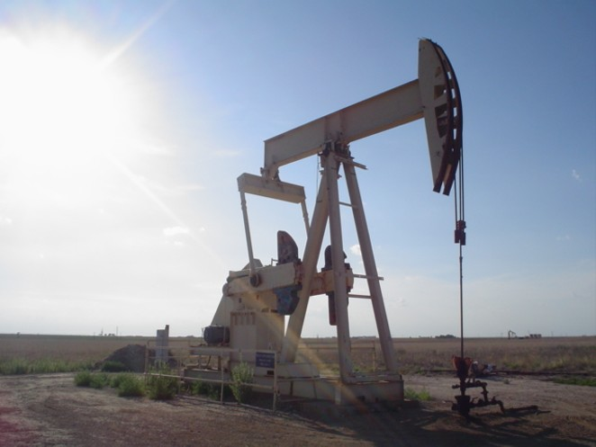 A pump jack operates in rural Texas. - WIKIMEDIA COMMONS / FLCELLOGUY