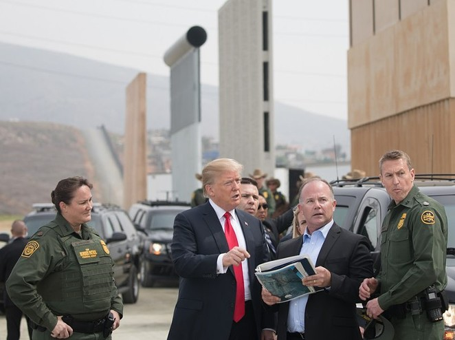 President Donald Trump reviews U.S. Customs and Border Protection's wall prototypes in Otay Mesa, California, last year. - WIKIMEDIA COMMONS / U.S. WHITE HOUSE