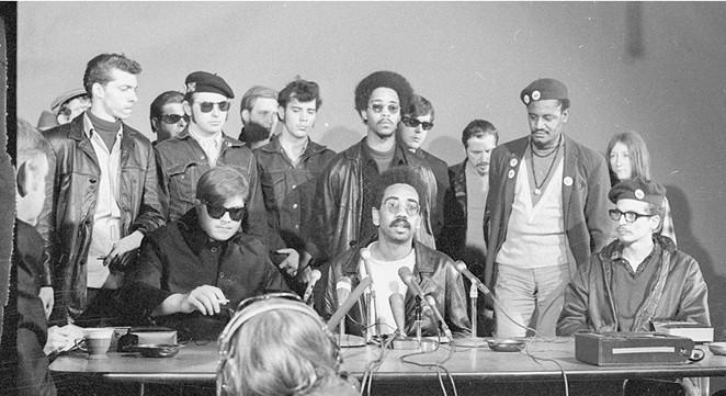 Members of the Rainbow Coalition speak at a press conference. - THE DAILY HERALD