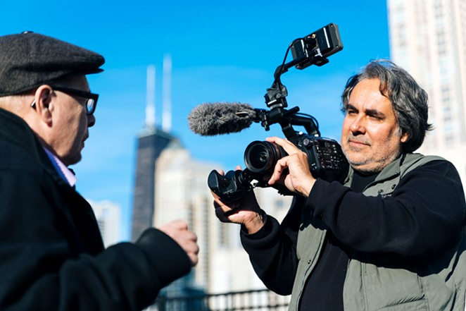 Ray Santisteban (right) conducts an interview for his film The First Rainbow Coalition. - PBS
