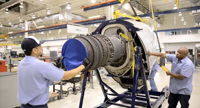 Standard Aero employees at Port San Antonio work on an engine. - COURTESY PHOTO / PORT SAN ANTONIO