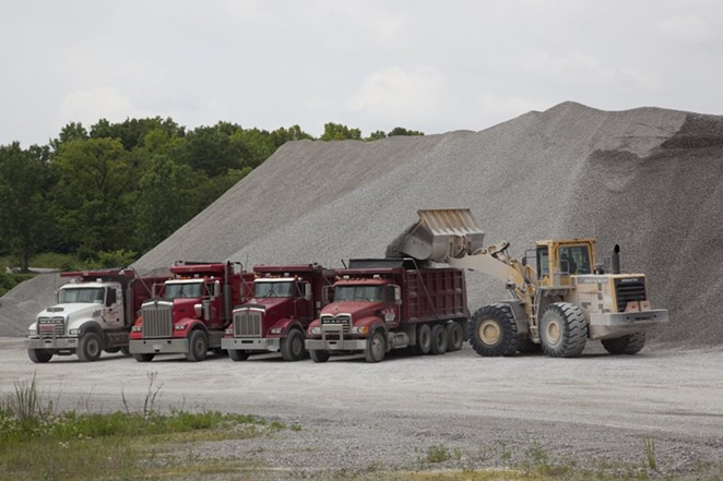 Trucks work at a Vulcan Materials limestone quarry in Tuscumbia, Alabama. - WIKIMEDIA COMMONS / GEORGE F. LANDEGGER