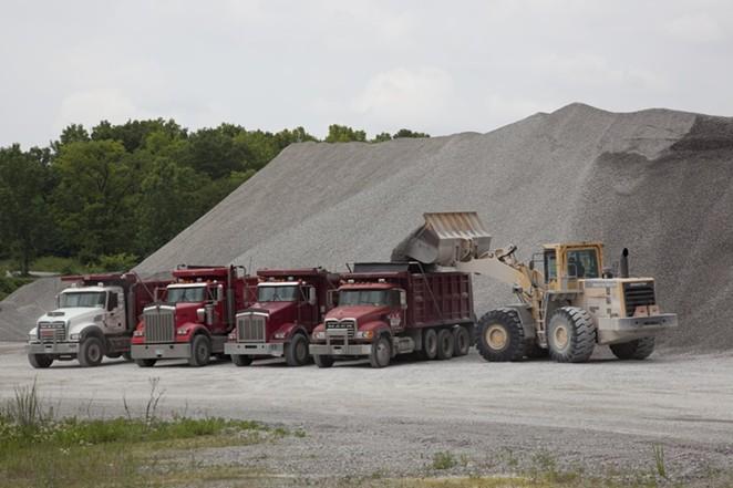 Trucks work at a Vulcan Materials limestone quarry in Tuscumbia, Alabama. - WIKIMEDIA COMMONS / GEORGE F. LANDEGGER