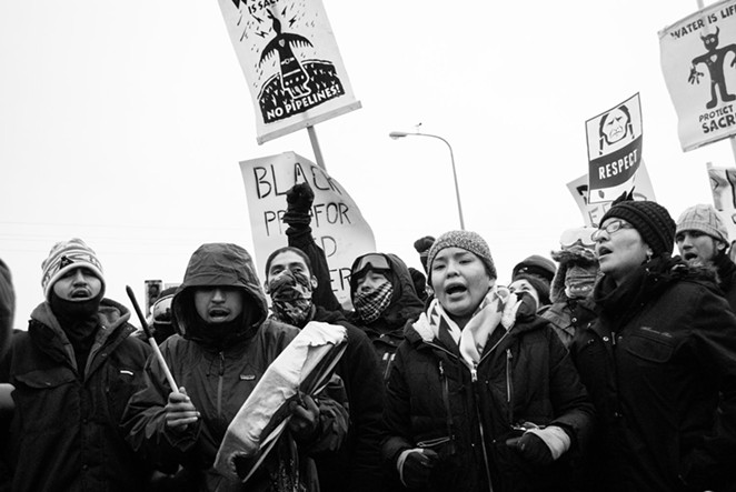 """Erick Iñiguez's 2016 photograph Standing Rock Thankstaking is among the works featured in """"XicanX."""" - ERICK IÑIGUEZ"""