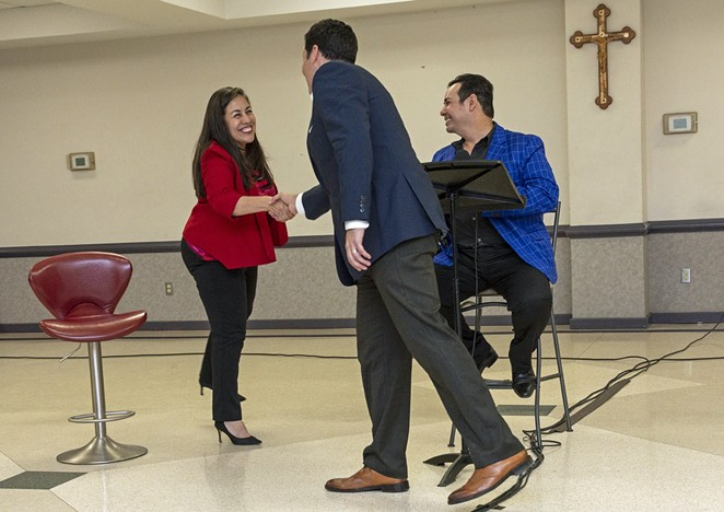 Queta Rodriguez (left) shakes the hand of Justin Rodriguez at a forum before the Super Tuesday primary. - MARK HIEBERT
