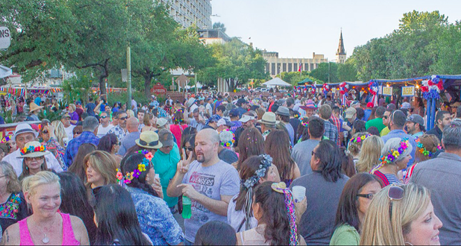 Revelers flood the popular Night in Old San Antonio Event during a past Fiesta. - BK MKEE