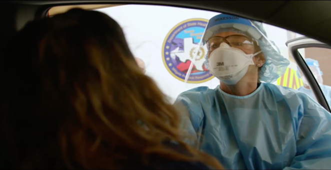 A patient in an automobile obtains a COVID-19 test in a video shot by the State of Texas. - SCREEN CAPTURE / STATE OF TEXAS