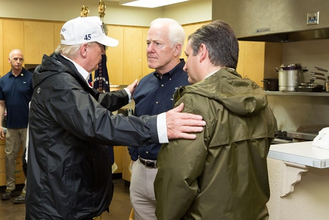 Donald Trump clasps the shoulders of Republican Senators from Texas John Cornyn (middle) and Ted Cruz (right). - THE WHITE HOUSE
