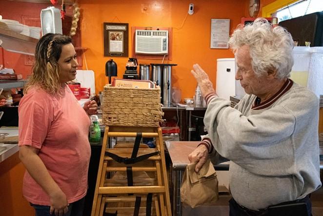 Tom Keene, 85, waves to co-owner Rocio Valdez at Mama's Kitchen, 504 W. Hildebrand Ave., on Thursday. - V. FINSTER | HERON CONTRIBUTOR