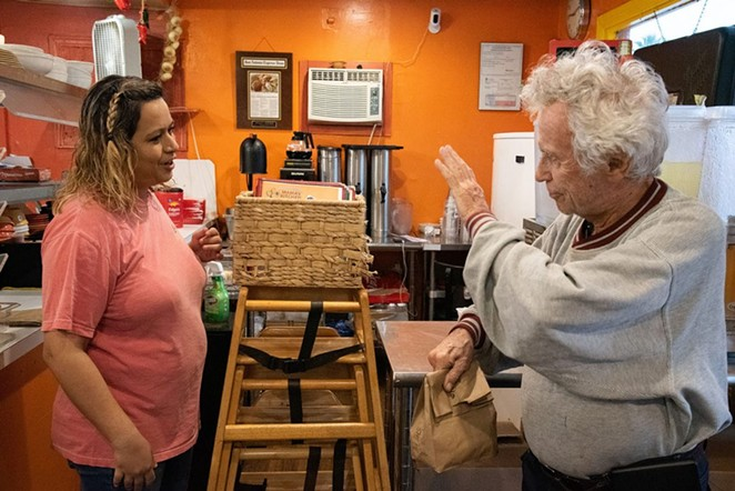 Tom Keene, 85, waves to co-owner Rocio Valdez at Mama's Kitchen, 504 W. Hildebrand Ave., on Thursday. - V. FINSTER | HERON CONTRIBUTOR